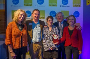 Rose and the PaD team receive the award from John Craven